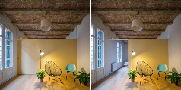 בין הסלון לחדר השינה הראשי מפריד קיר עם דלת הזזה שנצבעה בגוון הקיר