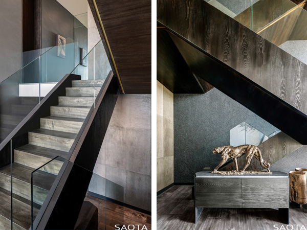 גרם מדרגות פיסולי העשוי עץ ומזכיר בצורתו סרט בד מקופל המחבר את כל המפלסים יחד